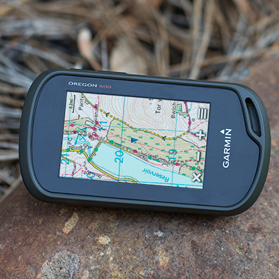 GARMIN<sup>&reg;</sup> Oregon<sup>&reg;</sup> 600 3-inch Worldwide Handheld GPS - Get out and explore with this handheld GPS navigation system.  Rugged 3-inch enhanced sunlight-readable touchscreen features 3-axis compass, accelerometer, barometric altimeter, dual-band GPS/GLONASS satellite positioning and high-speed USB.  Uses rechargeable NiMH pack or traditional AA batteries (not included).